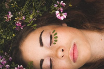 woman sleeping with pink flowers